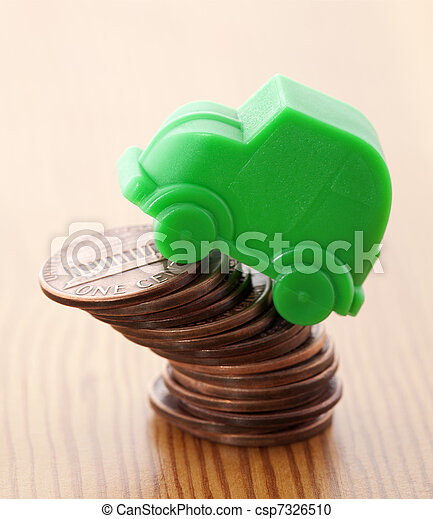 Green car miniature over pennies - csp7326510