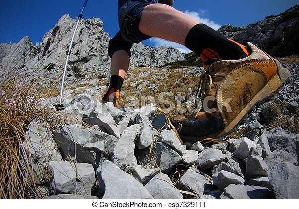 View of hikers legs with trekking boots - csp7329111