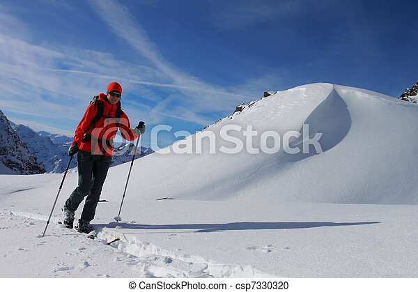 Young woman doing ski touring. Outdoor winter activity - csp7330320