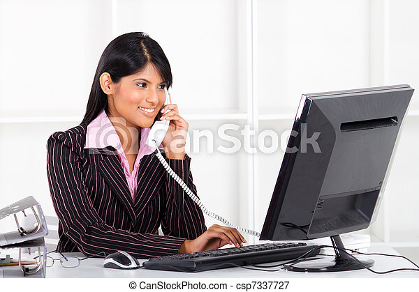 businesswoman working in office - csp7337727