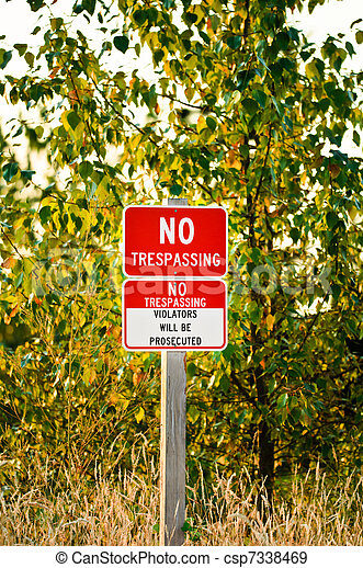 No Trespassing Sign on a wooden post. - csp7338469