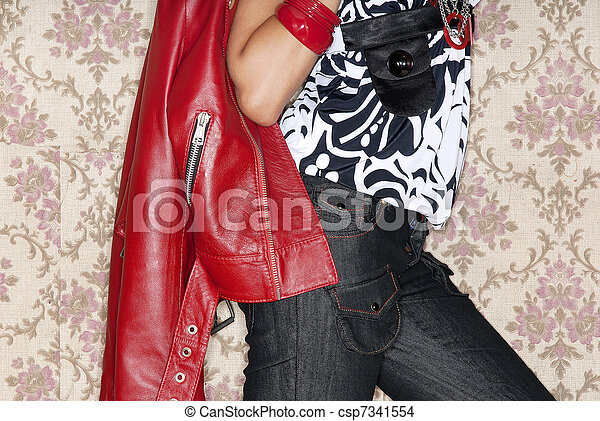 fashion model detail posing with red jacket - csp7341554
