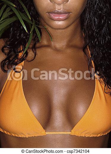 photo of girl breasts in orange bikini - csp7342104