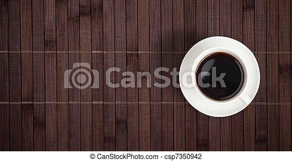Coffee cup top view on bamboo table - csp7350942