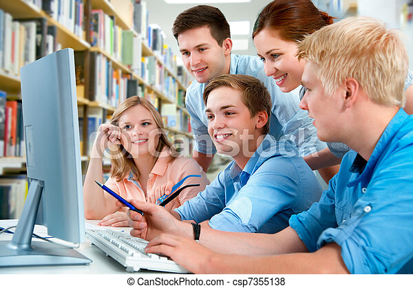 students in a college library - csp7355138