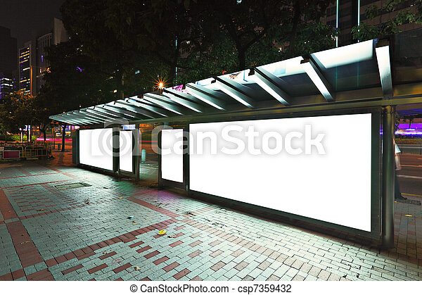 Blank billboard on bus stop at night  - csp7359432