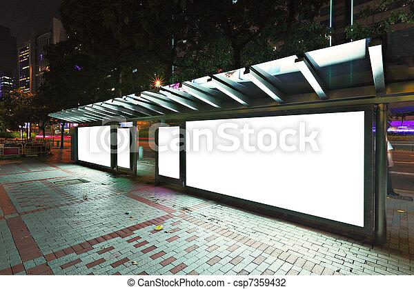 Blank billboard on bus stop at night  - csp7359432