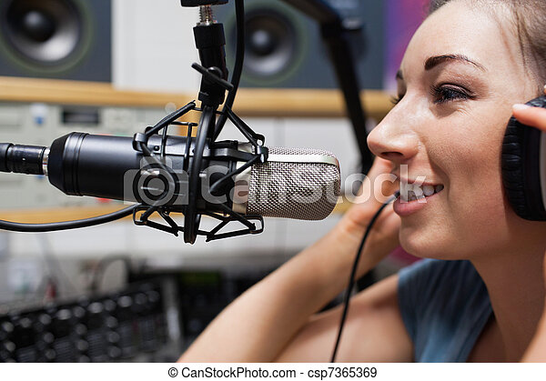 Close up of a young radio host speaking - csp7365369