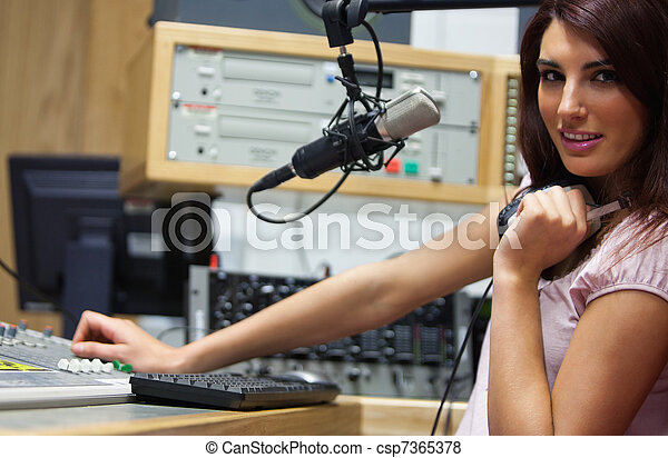 Radio host setting the sound - csp7365378