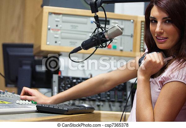 Radio host setting the sound - csp7365378