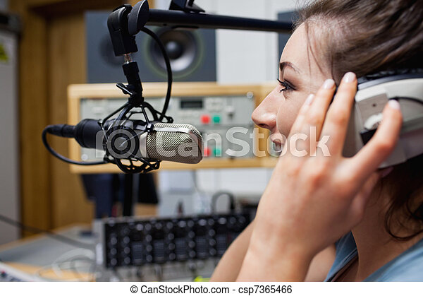 Smiling radio host speaking - csp7365466