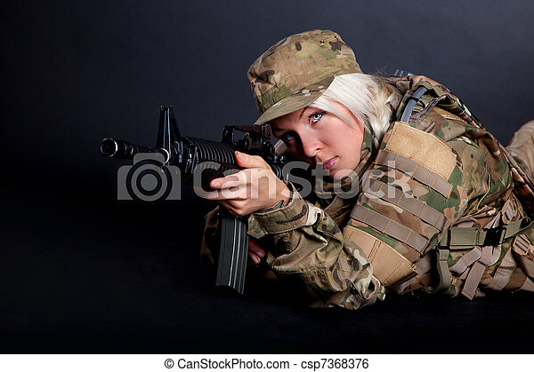 Beautiful army girl with rifle - csp7368376