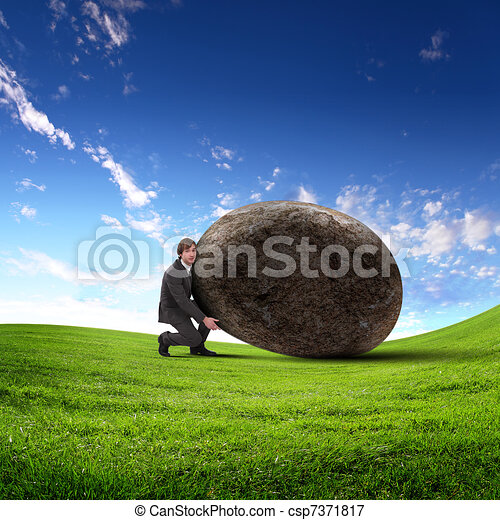 Businessman rolling a giant stone - csp7371817