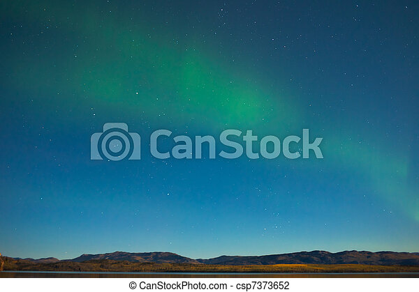 Northern lights and fall colors in moon-lit night - csp7373652