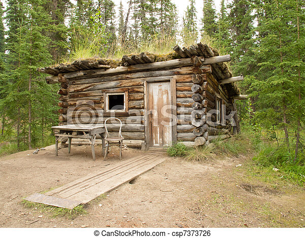 Old traditional log cabin rotting in Yukon taiga - csp7373726