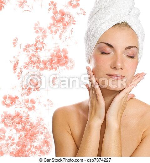 Young lovely lady applying moisturizer to her face after shower - csp7374227