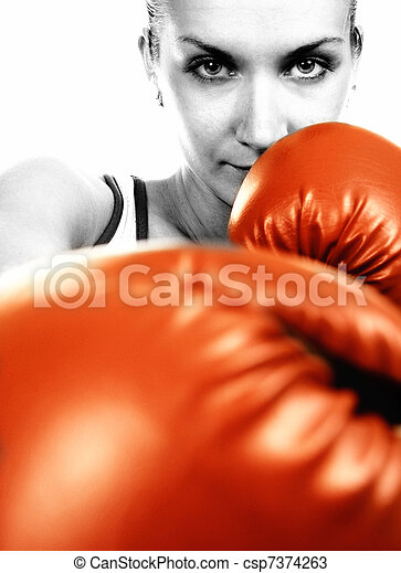 Sepia portrait of a girl in red boxing gloves - csp7374263