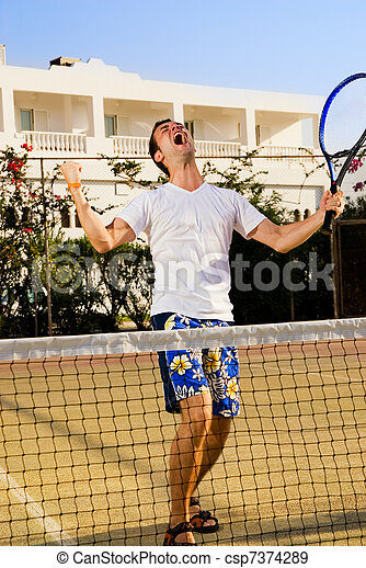 Tennis player screaming after winning a game - csp7374289