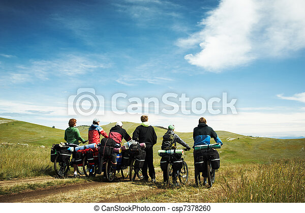 Group of bicyclists going on road. Lake Baikal island Olkhon - csp7378260