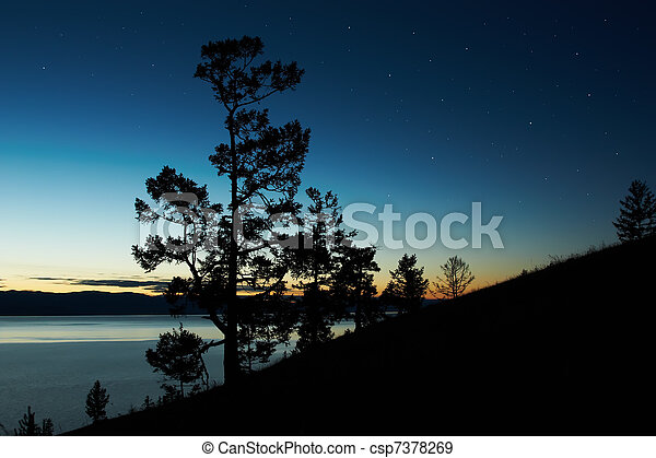Night landscape against a decline lake Baikal - csp7378269