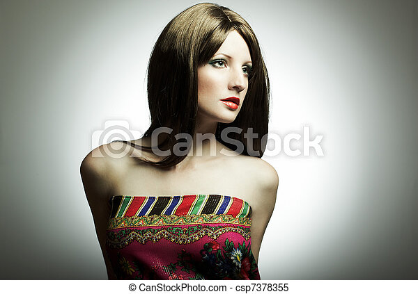 Fashion portrait of the young woman in studio - csp7378355