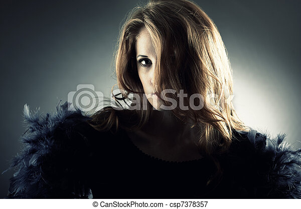 Fashion portrait of the young woman in studio - csp7378357