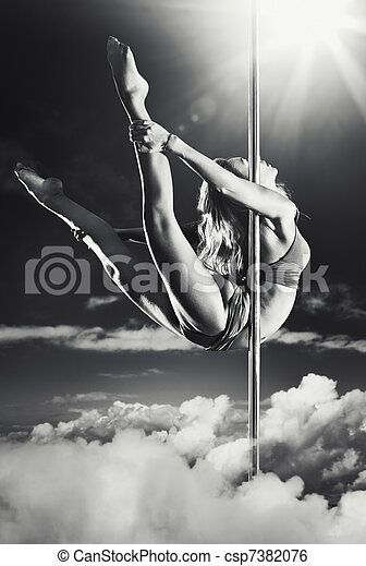 Young pole dance woman - csp7382076