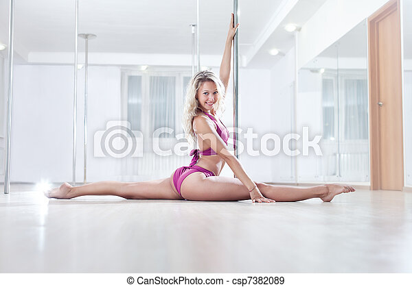 Young pole dance woman - csp7382089