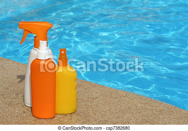 bottles of sun protection cream or lotion for summer vacation - csp7382680