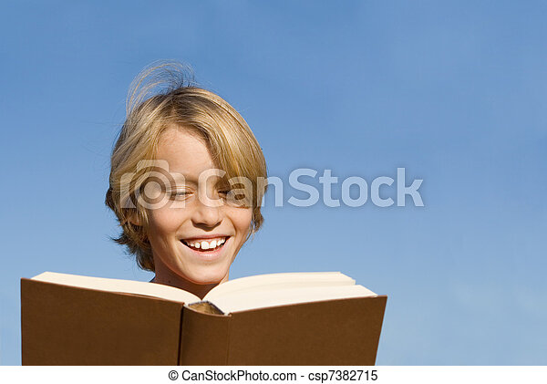 happy child or kid reading book or bible - csp7382715