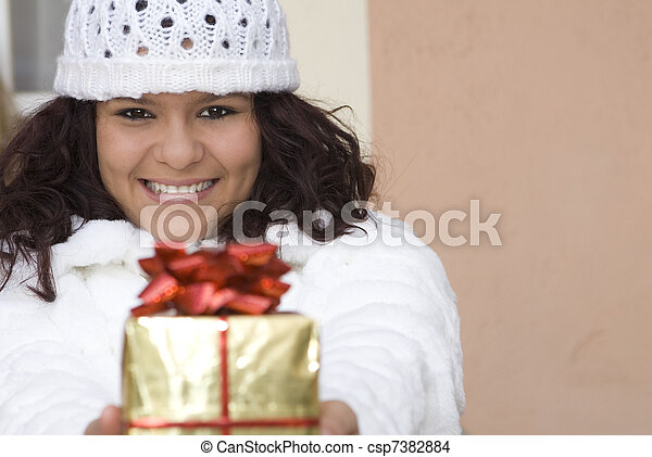 happy girl giving christmas holiday or birthday gift or present - csp7382884