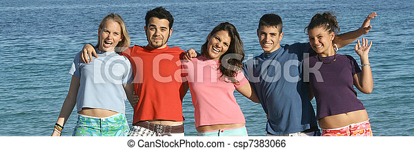 friendship group of teens, youth, kids or students at the beach,  - csp7383066