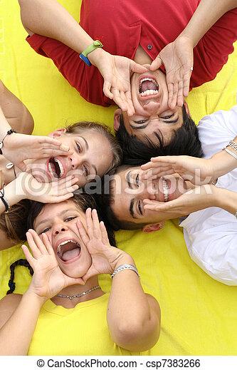 group of happy teens shouting or singing - csp7383266