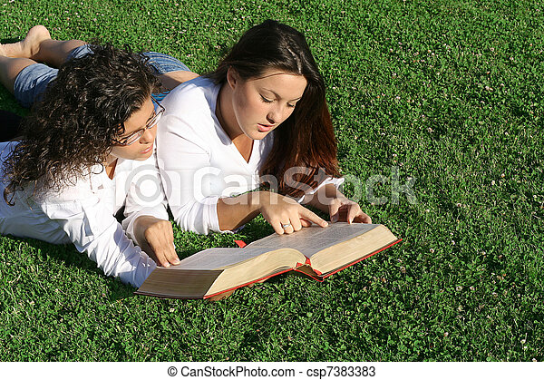 young women reading at bible camp or study group - csp7383383