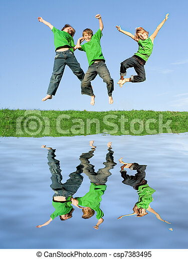 group or team of kids jumping for joy celebrating win - csp7383495