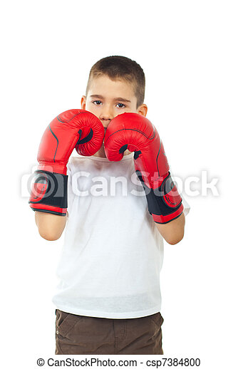 Boy defending with boxing gloves - csp7384800
