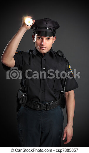 Policeman or Security Guard shining a torch - csp7385857