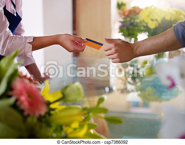 client with credit card shopping in flowers shop  - csp7386092