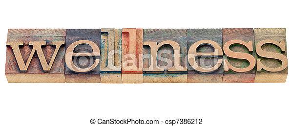 wellness word in letterpress type - csp7386212
