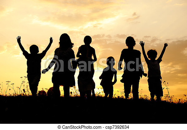 Silhouette, group of happy children playing on meadow, sunset, summertime - csp7392634