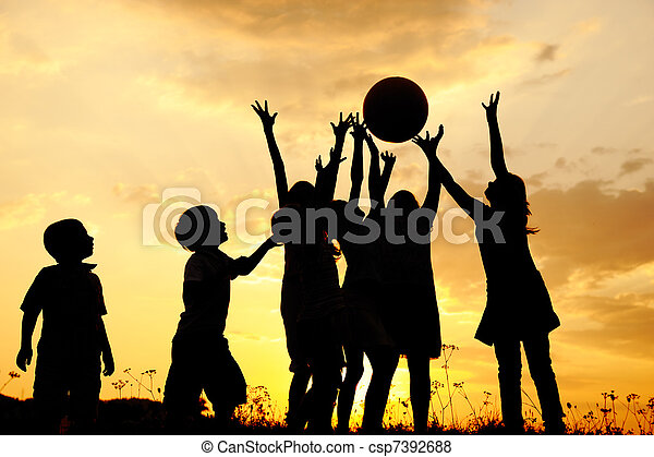 Silhouette, group of happy children playing on meadow, sunset, summertime - csp7392688