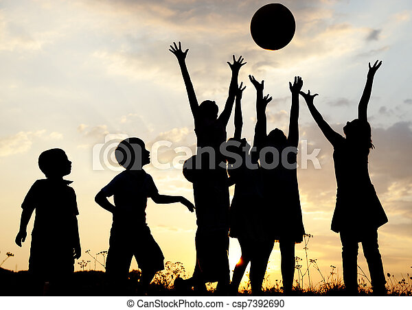 Silhouette, group of happy children playing on meadow, sunset, summertime - csp7392690