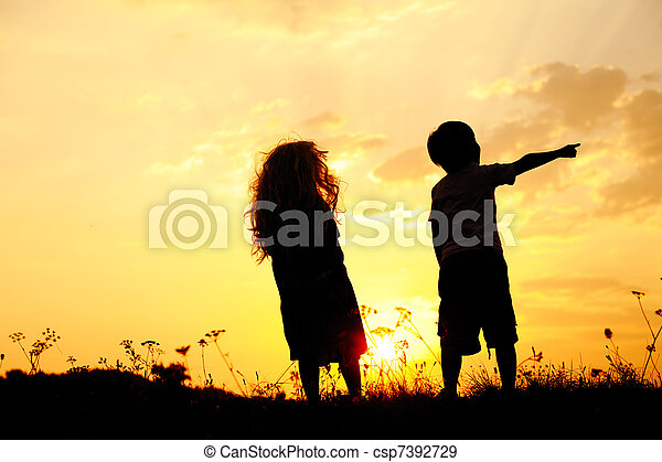Silhouette, group of happy children playing on meadow, sunset, summertime - csp7392729