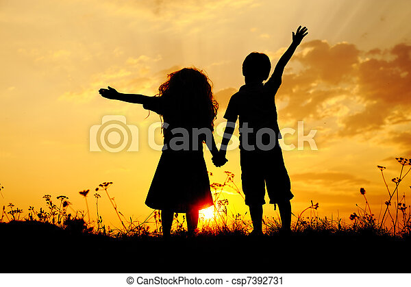 Silhouette, group of happy children playing on meadow, sunset, summertime - csp7392731