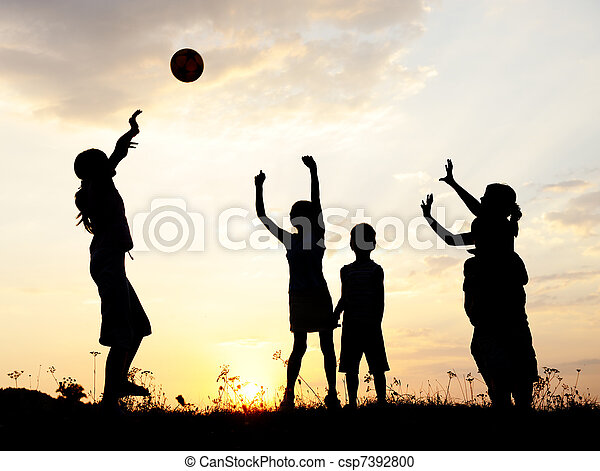 Silhouette, group of happy children playing on meadow, sunset, summertime - csp7392800