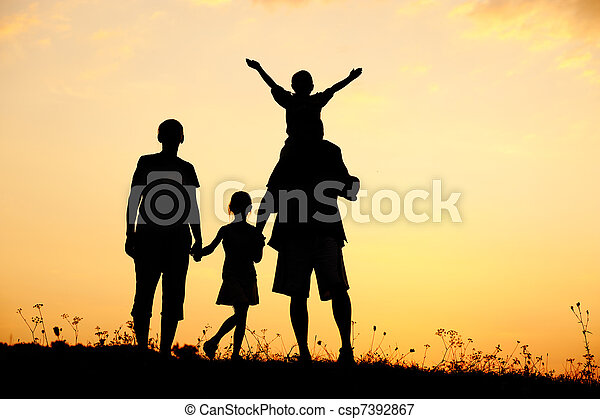 Silhouette, happy children with mother and father, family at sunset, summertime - csp7392867