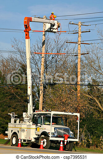 Worker fixing power line - csp7395531