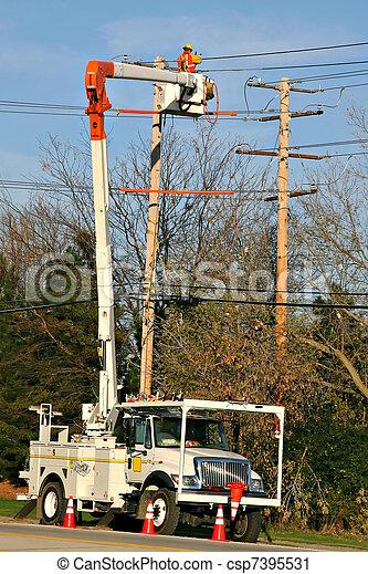 Worker fixing power line - csp7395531