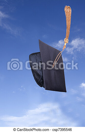 Graduation Hat in the Air under Blue Sky - csp7395546
