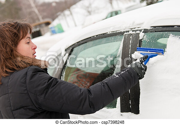 Winter time - person cleaning car - csp7398248